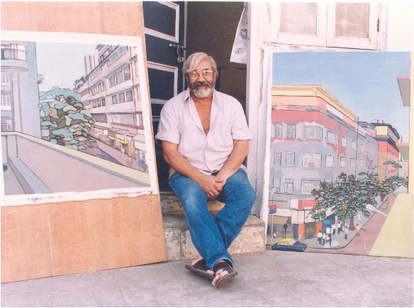 Markand Thakar sitting with two of his paintings.